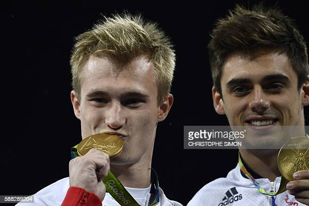 Great Britain's Jack Laugher and Chris Mears celebrate with their gold medal during the podium ceremony for the Men's Synchronised 3m Springboard...