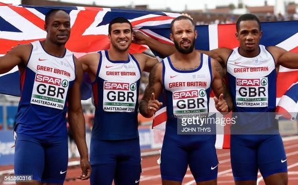Great Britain's James Dasaolu Adam Gemili James Ellington and Chijindu Ujah pose after winning the men's 4x100m relay during the European Athletics...