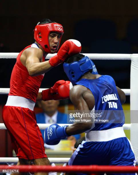 Great Britain's James Degale Cubas' Emilio Correa Bayeaux in the men's middleweight boxing final during the 2008 Beijing Olympic Games China