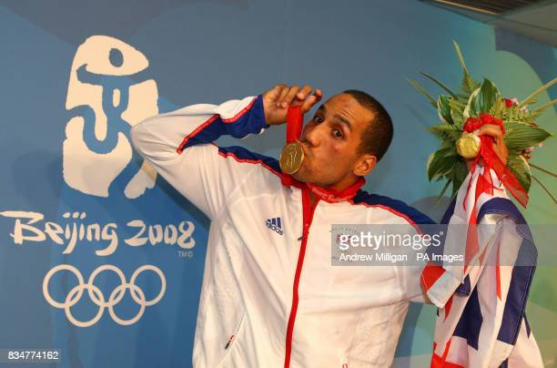 Great Britain's James Degale kisses his gold medal after beating Cubas' Emilio Correa Bayeaux in the men's middleweight boxing final at the Workers...
