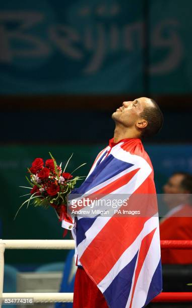 Great Britain's James Degale listens to the National Anthem as he stands with his gold medal following his victory over Cubas' Emilio Correa Bayeaux...