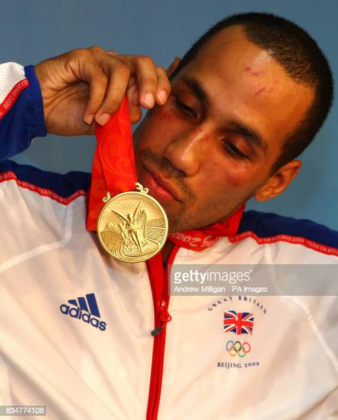 Great Britain's James Degale looks at his gold medal after beating Cubas' Emilio Correa Bayeaux in the mens middleweight boxing final at the Workers...