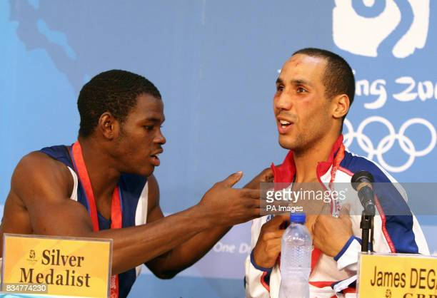 Great Britain's James Degale shows Cubas' Emilio Correa Bayeaux the bite mark he left on him in round one in a press conference after the men's...