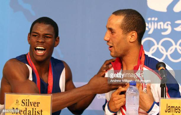 Great Britain's James Degale shows Cubas' Emilio Correa Bayeaux the bite mark he left on him in round one in a press conference after the mens...