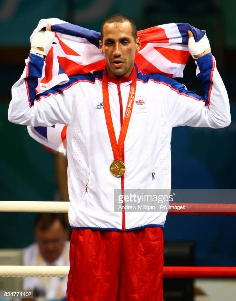 Great Britain's James Degale stands with his gold medal following his victory over Cubas' Emilio Correa Bayeaux in the men's middleweight boxing...