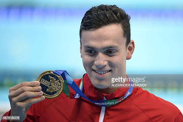 Great Britain's James Guy gold poses during the podium ceremony of the men's 200m freestyle swimming event at the 2015 FINA World Championships in...