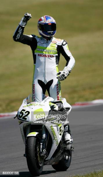 Great Britain's James Toseland celebrates victory in the fisrt race of the SBK Superbike World Championship at Brands Hatch Circuit Kent