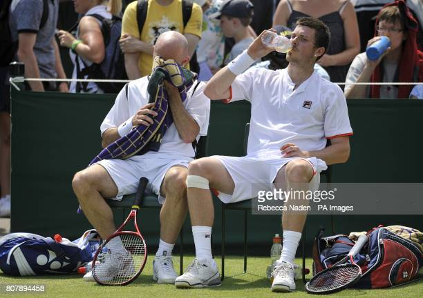 Great Britain's Jamie Delgado and Joshua Goodall take a break from the action in their doubles match against Spain's Nicolas Almagro and Santiago...