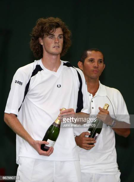 Great Britain's Jamie Murray and South Africa's Jeff Coetzee stand dejected after losing out to Brazil's Bruno Soares and Zimbabwe's Kevin Ullyett in...