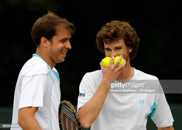 Great Britain's Jamie Murray shares a joke with his doubles partner Luvxembourg's Gilles Muller during their match against South Africa's Jeff...