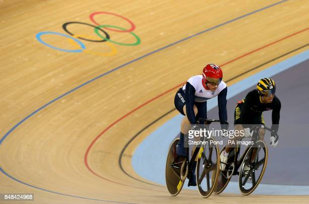 Great Britain's Jason Kenny secures victory over Malaysia's Azizulhasni Awang in the men's sprint at the Olympic Velodrome London
