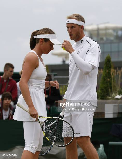 Great Britain's Johanna Konta and Dominic Inglot in their Mixed Doubles match against Canada's Daniel Nestor and France's Kristina Mladenovic during...