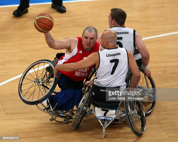 Great Britain's Jon Pollock battles with Germany's Lars Lehmann in a battle for the ball during the Men's Wheelchair Basketball QuarterFinals