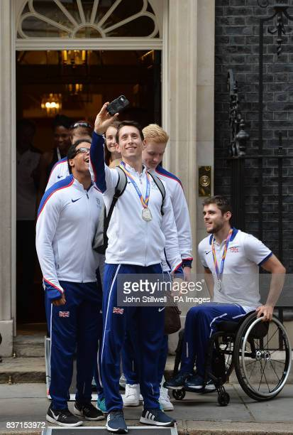 Great Britain's Jonathan BroomEdwards takes a selfie as they leave 10 Downing Street in London after attending a reception hosted by Prime Minister...