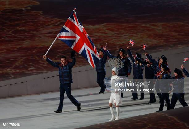 Great Britain's Jonathan Eley leads his team mates out during the Opening Ceremony for the 2014 Sochi Olympic Games in Sochi Russia
