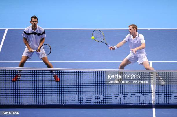 Great Britain's Jonathan Marray and Denmark's Frederik Nielsen in action during their Men's Doubles Group B match against Sweden's Robert Lindstedt...