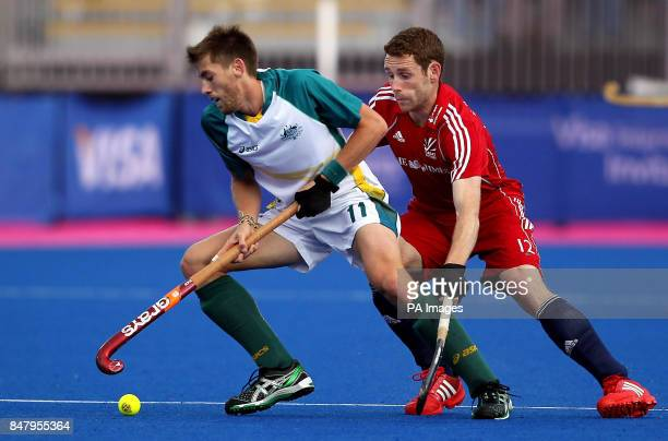 Great Britain's Jonty Clarke in action against Australia's Edward Ockenden during the Visa International Invitational Hockey Tournament at the...