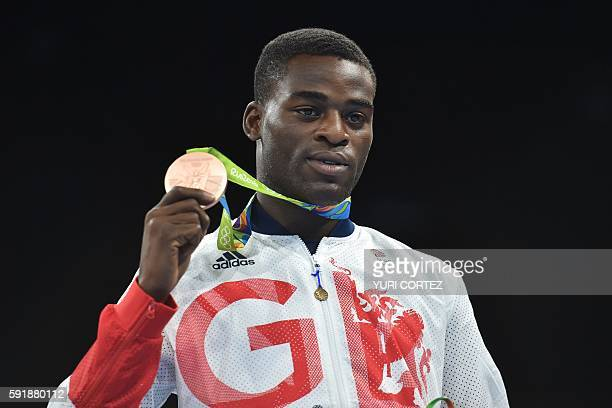 Great Britain's Joshua Buatsi poses on the podium with a medal at the Rio 2016 Olympic Games at the Riocentro Pavilion 6 in Rio de Janeiro on August...