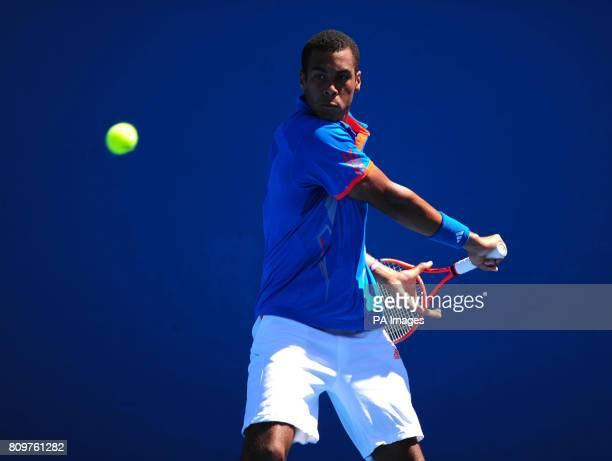 Great Britain's Joshua WardHibbert in action against Italy's Stefano Napolitano during day nine of the 2012 Australian Open at Melbourne Park in...