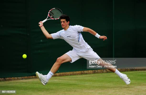 Great Britain's Julian Cash in action against Germany's Alexander Zverev during day eight of the Wimbledon Championships at The All England Lawn...