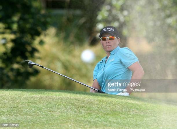 Great Britain's Karen Stupples watches her bunker shot land on the first green during the final round of the Weetabix Women's British Open at Royal...