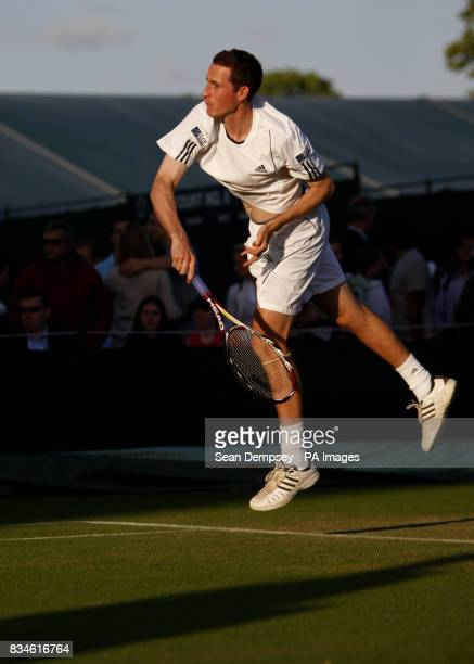 Great Britain's Ken Skupski in his doubles match with Richard Bloomfield during The Wimbledon Championships at The All England Lawn Tennis Club...