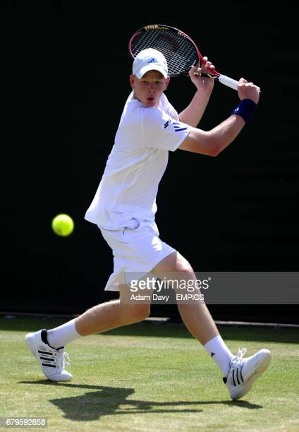 Great Britain's Kyle Edmund in action during his match against Brazil's Joao Pedro Sorgi in the boys singles on day seven of the 2011 Wimbledon...
