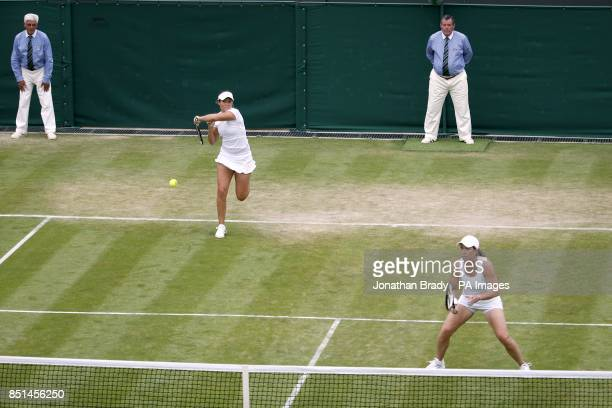 Great Britain's Laura Robson and USA's Lisa Raymond in action in their women's doubles match against Germany's AnnaLena Groenefeld and Czech...