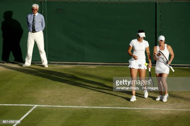 Great Britain's Laura Robson and USA's Lisa Raymond in conversation in their women's doubles match against Germany's AnnaLena Groenefeld and Czech...
