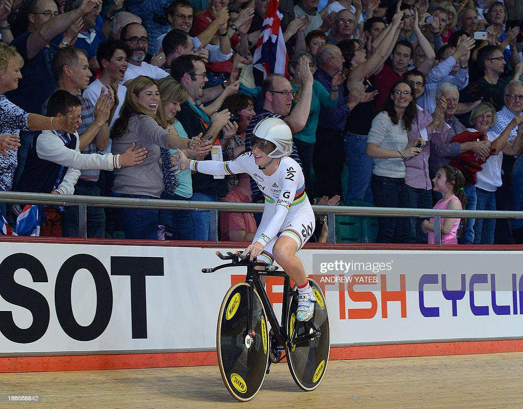 Great Britain's Laura Trott celebrates after her team won the Women's Team Pursuit during day one of the Track Cycling World Cup at The National Cycling Centre in Manchester, north-west England, on November 1, 2013. AFP PHOTO/ANDREW YATES