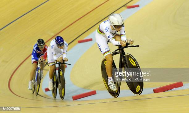 Great Britain's Laura Trott rides away from pursuit teamates Dani King and Elinor Barker in qualifying during day one of the UCI Track Cycling World...