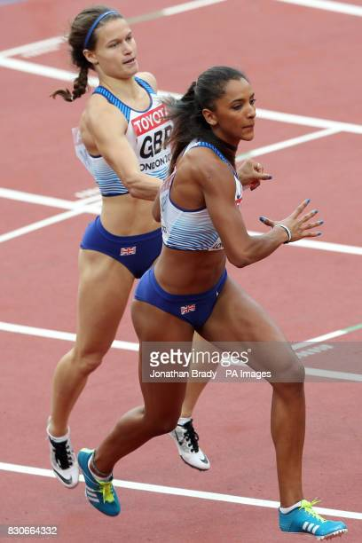 Great Britain's Laviai Nielsen receives the baton from Zoey Clark in the Women's 4x400m Relay during day nine of the 2017 IAAF World Championships at...