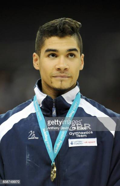 Great Britain's Louis Smith celebrates winning the Gold medal in the Pommel Horse final during the Visa International Gymnastics at the North...