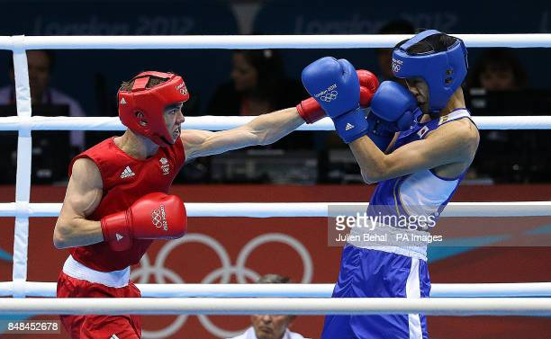 Great Britain's Luke Cambell in action against Japan's Satoshi Shimizu in their Men's Boxing BantamWeight 56kg fight at the Excel Arena London