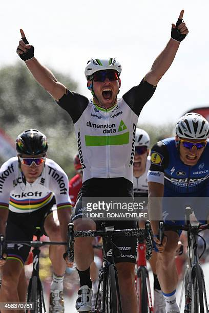 Great Britain's Mark Cavendish celebrates as he crosses the finish line ahead of Germany's Marcel Kittel and Slovakia's Peter Sagan at the end of the...
