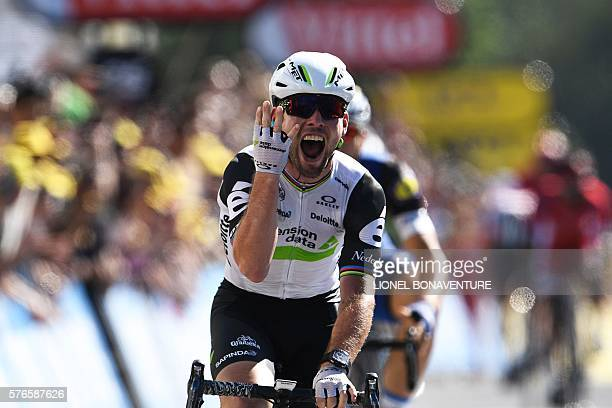 Great Britain's Mark Cavendish celebrates as he crosses the finish line during the 2085 km fourteenth stage of the 103rd edition of the Tour de...