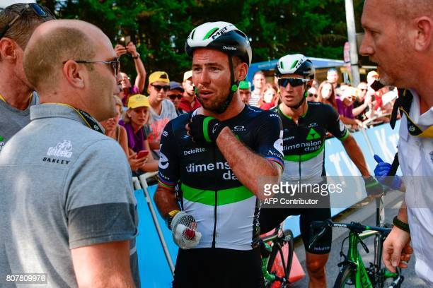 Great Britain's Mark Cavendish injured speaks after falling near the finish line at the end of the 2075 km fourth stage of the 104th edition of the...