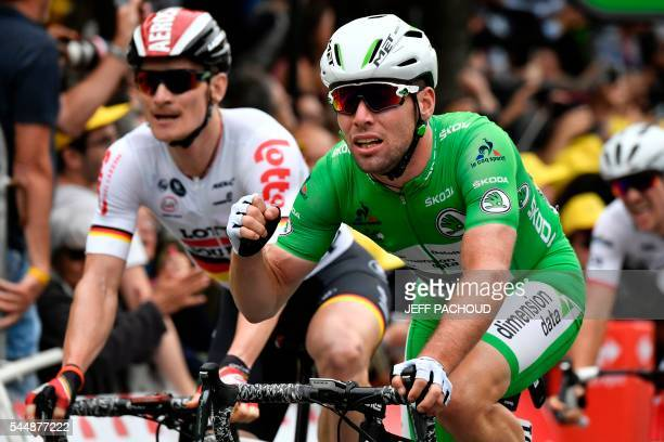 CORRECTION Great Britain's Mark Cavendish reacts as he crosses the finish line next to Germany's Andre Greipel at the end of the 2235 km third stage...