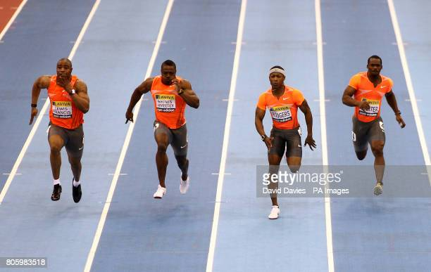 Great Britain's Mark LewisFrancis and Harry Aikines Aryeetey race against USA's Michael Rodgers and Jamaica's Nesta Carter in the men's 60m