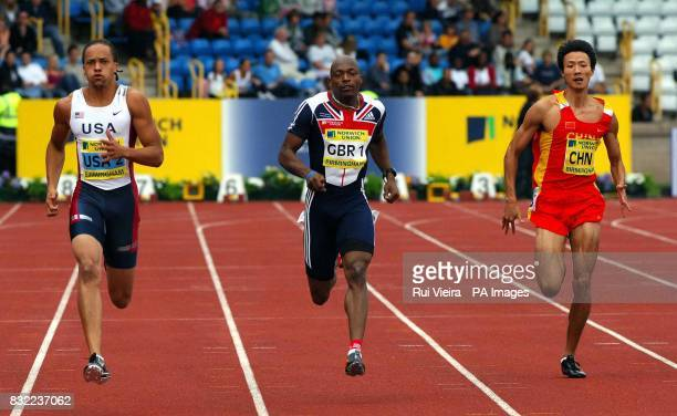 Great Britain's Marlon Devonish finishes second to USA's Wallace Spearmon during the Norwich Union International at the Alexander Stadium Birmingham