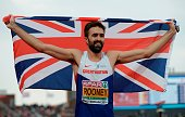 Great Britain's Martyn Rooney reacts as he crosses the finish line to win the men's 400 final race during the European Athletics Championships in...