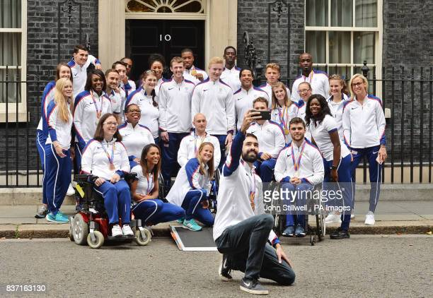 Great Britain's Martyn Rooney takes a selfie with British athletes as they leave 10 Downing Street in London after attending a reception hosted by...