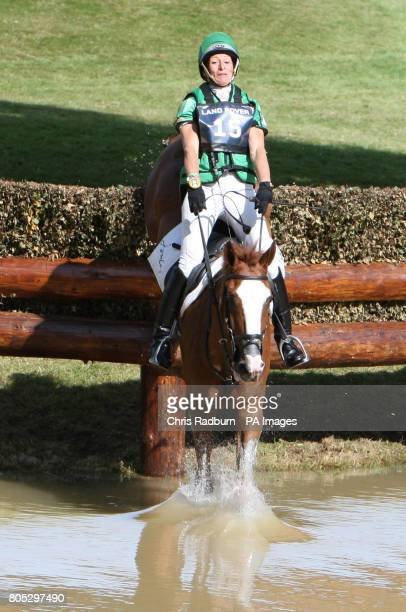 Great Britain's Mary King and Apache Saurce ride through the Trout Hatchery as they compete in the Cross Country during day three of the Burghley...
