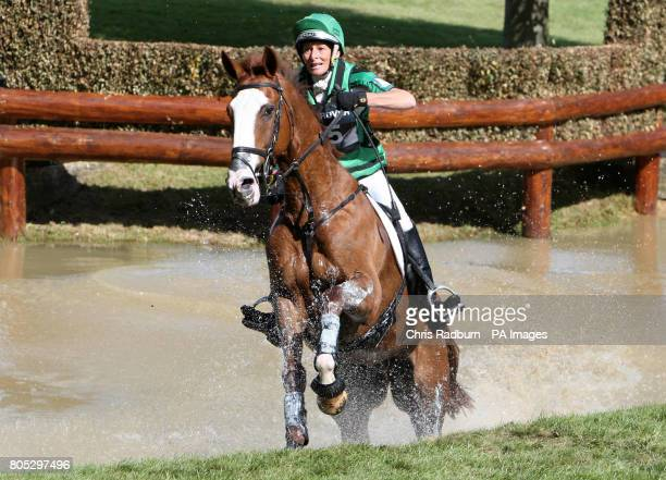 Great Britains Mary King and Apache Saurce ride through the Trout Hatchery as they compete in the Cross Country during day three of the Burghley...
