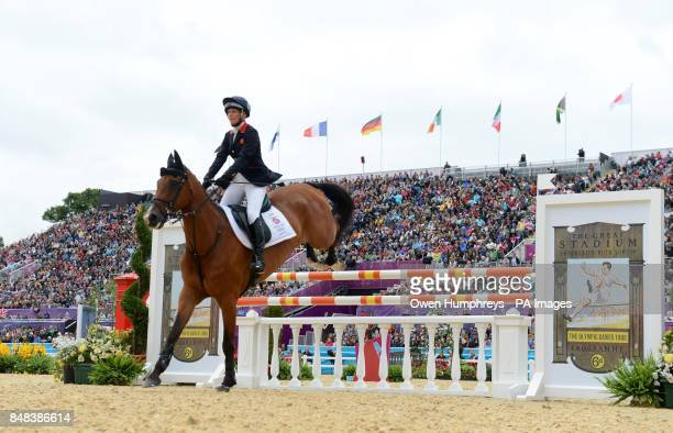 Great Britain's Mary King on Imperial Cavalier as they knock a fence during the Individual Eventing Jumping Final on day four of the London Olympic...