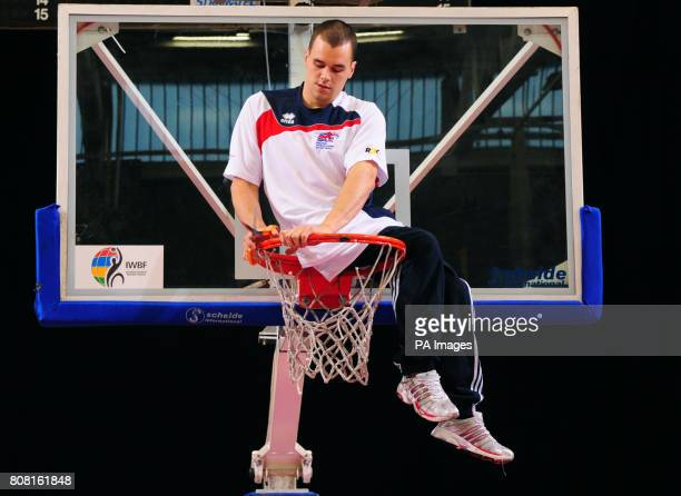 Great Britain's Matt Sealy cuts down the basket after the Wheelchair Basketball match during the BT Paralympic World Cup at Sport City Manchester
