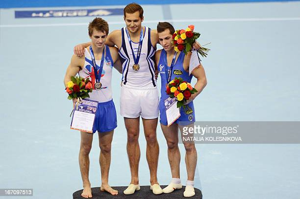 Great Britain's Max Whitlock Israel's Alexander Shatilov and Italy's Andrea Cingolani celebrate on the podium during the men's apparatus artistic...
