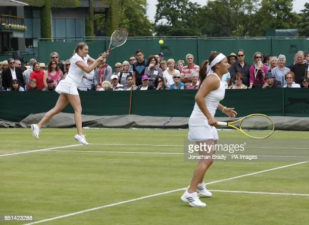 Great Britain's Melanie South and Tara Moore in action against Spain's Silvia SolerEspinosa and Carla Suarez Navarro during day four of the Wimbledon...