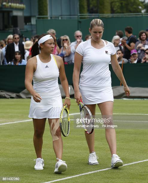 Great Britain's Melanie South and Tara Moore walk off dejected during their match against Spain's Silvia SolerEspinosa and Carla Suarez Navarro...