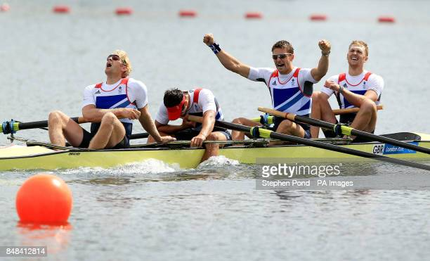 Great Britain's Men's Four of Andrew Triggs Hodge Tom James Pete Reed and Alex Gregory celebrate winning gold in the final at Eton Dorney Rowing Lake...